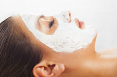 Young woman with natural facial mask Stock Photo