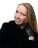 Young woman in a natural fur coat Stock Photography