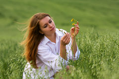 Young fashion woman in white shirt on nature Royalty Free Stock Photo