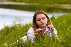 Young woman on nature. Royalty Free Stock Photos