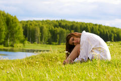 Young woman on nature Royalty Free Stock Photos