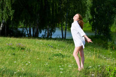 Young woman relaxing on nature. Young woman relaxing on the shore of lake Stock Photo
