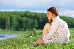 Young woman on nature. Royalty Free Stock Image