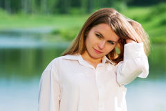 Young woman on nature. Royalty Free Stock Images