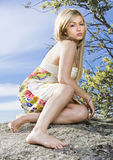 Young woman in the nature. Young blonde beautiful woman posing near a lake Royalty Free Stock Image