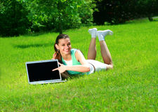 Young woman on a nature. With the laptop stock photos