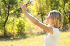 Young woman on nature Royalty Free Stock Images