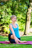 Young woman in nature doing yoga Stock Photo