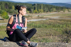 Young woman on nature with a map in hand. Young woman with map in hand on a camping trip on vacation Royalty Free Stock Photo