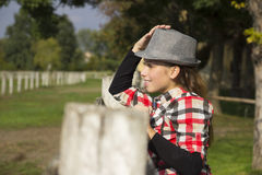 Young woman in nature. On a ranch with horses Stock Photo