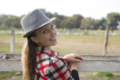 Young woman in nature. On a ranch with horses Stock Images