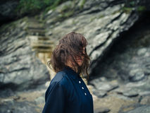 Young woman in nature by stairs leading up cliff Royalty Free Stock Photo