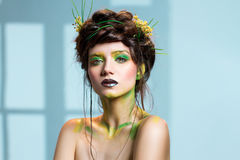 Young woman, nature themed makeup. Stock Image