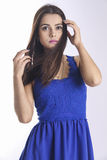 Young woman in navy blue dress on white Royalty Free Stock Photography