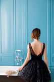 Young woman near bath. Photo of beautiful young woman standing near bath and looking at it Royalty Free Stock Image