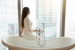 Young woman near the bath Stock Photography