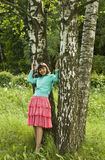 Young woman near birch trees Stock Photos