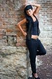 Young woman near brick wall royalty free stock photos