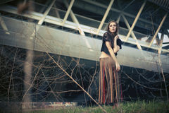 Young woman near the bridge Royalty Free Stock Photography