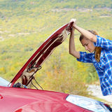 Young woman near broken car Royalty Free Stock Photos