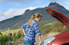 Young woman near broken car Royalty Free Stock Image