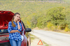Young woman near broken car speaking by phone Royalty Free Stock Images