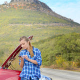 Young woman near broken car Royalty Free Stock Photo