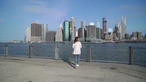Young woman near Brooklyn bridge stock video