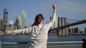Young woman near Brooklyn bridge stock video footage