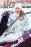 Young woman near the car at winter season Royalty Free Stock Photos