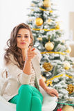 Young woman near christmas tree pointing in camera Stock Image