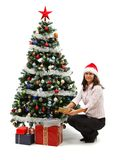 Young woman near Christmas tree with presents Royalty Free Stock Image