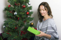 Young woman near decorated Christmas tree Royalty Free Stock Photo
