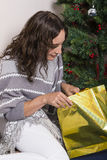 Young woman near decorated Christmas tree Royalty Free Stock Images