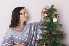 Young woman near decorated Christmas tree Royalty Free Stock Photos