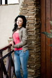 Young woman near the door Royalty Free Stock Image