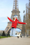 Young woman near the Eiffel tower, in Paris, France Royalty Free Stock Photo