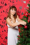 Young  woman near a fir-tree Stock Images
