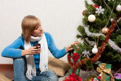 Young woman near a fir-tree Royalty Free Stock Image