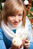 Young woman near a fir-tree Royalty Free Stock Photography