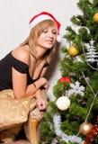 Young woman near a fir-tree Royalty Free Stock Photos