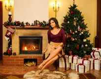 Young woman near fireplace Stock Photos