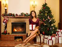Young woman near fireplace Stock Photography