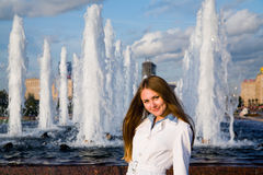 Young Woman Near The Fountain Royalty Free Stock Photos