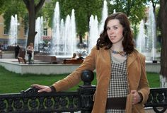 Young woman near fountain Stock Image