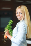 A young woman near the fridge with healthy food. Stock Photo