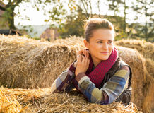 Young woman near haystack Stock Photos