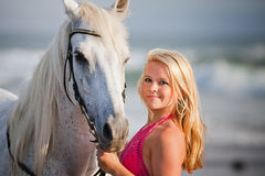 Young woman near the horse Stock Image