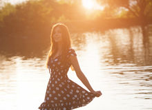 Young woman near the lake Royalty Free Stock Photos