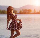 Young woman near the lake Royalty Free Stock Images